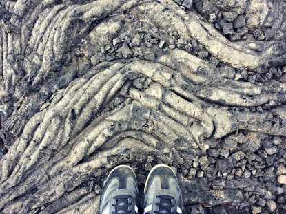 Exploring Volcanoes National Park and walking on hardened lava flows.