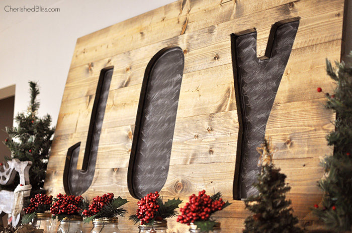 Build this DIY Christmas Joy Sign for UNDER $15! A great addition to your Christmas Decor
