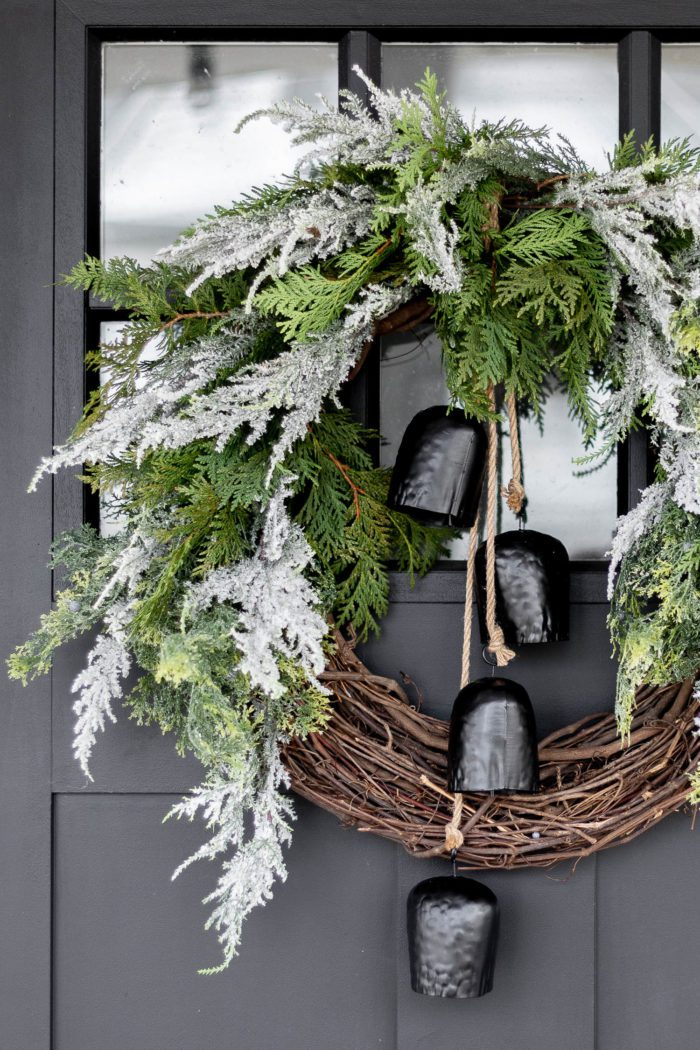 Gorgeous Christmas Evergreen Wreath with bells hanging in the middle.