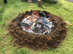 The burn is done when white ash forms on top. Char is formed below the fire front where oxygen cannot get to