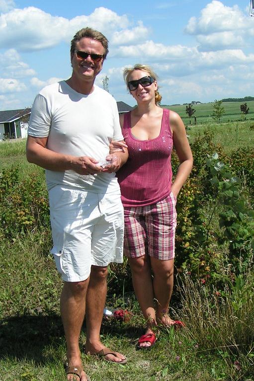 Gathering the last raspberry harvest.