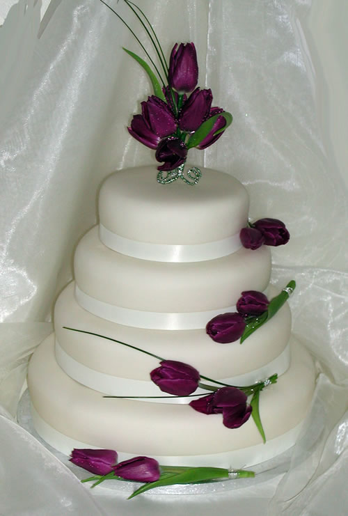 white wedding cakes with purple tulips