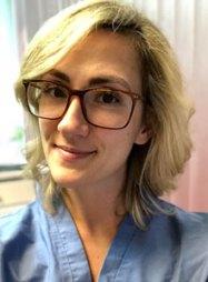 Dr Chris Cherubino in blue scrubs at Cherubino Health Center