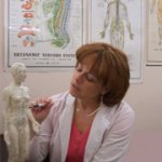 Deborah Walker teaching meridian acupuncture points to a patient at cherubino health center