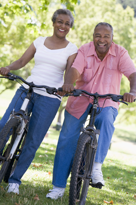 Photographs of an older couple on bicycles during a cherubino health center activity weekend