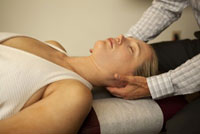 Woman being treated with Craniosacral Therapy and therapeutic massage
