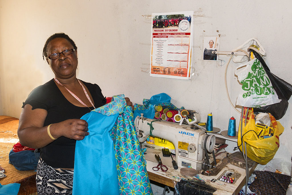 Tembe showing off her sewing skills