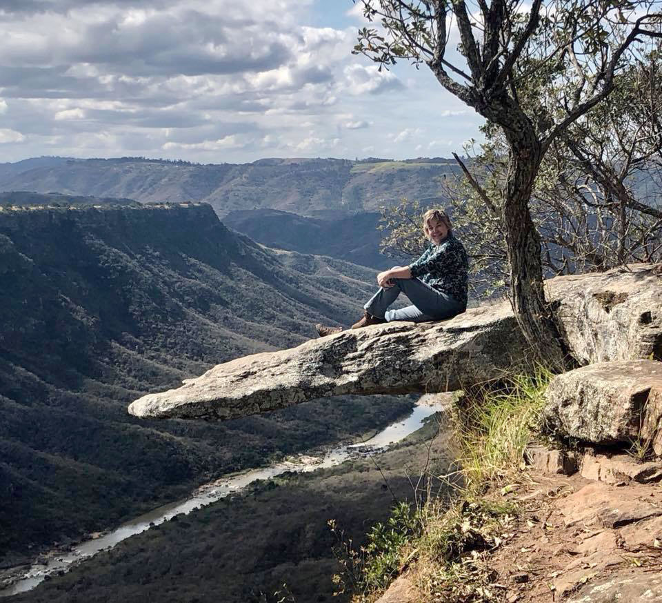 Cheryl sitting on Leopard Rock overlooking Oribi Gorge