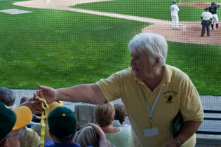 """During the summer months, Fleurette volunteers at every home game for the Sanford Mainers baseball team. In addition to the game itself, she also enjoys being part of a popular community-wide event. """"Everyone's here,"""" she says with a smile."""
