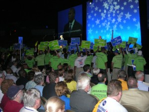 Placards surrounding Deval Patrick as he speaks 2010