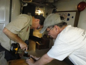 Greg and Andy working on electrical fixtures