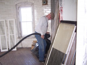 Al Smith cleans up after installing window.