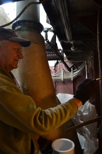 Photo by Anne Puppa Tony painting bulkhead in fidley.