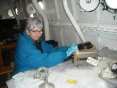 Barbara Witucki cleaning up electrical components
