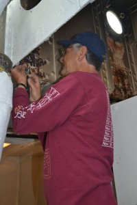 Tony chases the threads for electrical brackets in Fidley.
