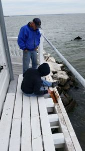 Hobie and Dick work on Deck.