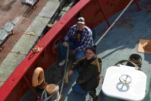 James and Andy add chaffing gear to mooring lines.