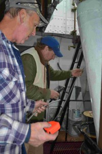 James and Jeff run wire in engine room fiddley.