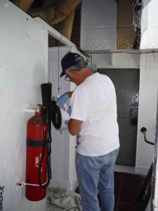 Tony painting a part of the signal light.