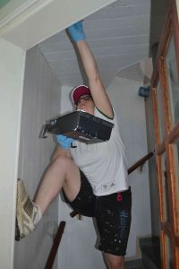 Cory painting the stairwell.