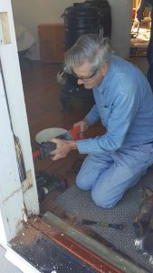Bernie Lammers working on doorframe.