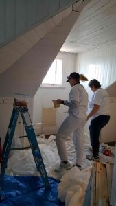 Carolyn and Helen painting second floor room.