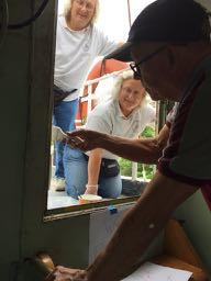 Lauren, Paula and Hobie work on door to half deck.