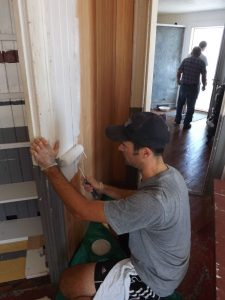 Michael Zajac primes a new equipment room wall