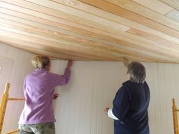 Katie & Virginia fill nail head holes and seams in ceiling with putty