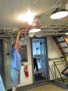 Jeff scraping ceiling in forward exhibit area