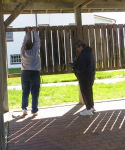 Trez and Carolyn at work removing slats from pavilion.