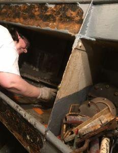 Anne scraping bin in Lathe room