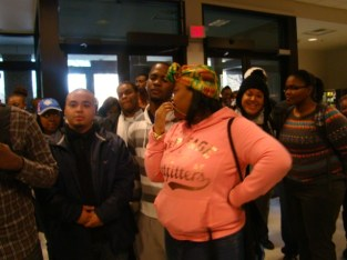 Students waiting for the results of the giveaway drawing in the Student Center, 2