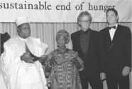 """Esther Afua Ocloo. Ocloo, second from left, and former Nigerian president Olusegun Obasanjo, left, receiving the Africa Prize for Leadership for the Sustainable End of Hunger, New York, 1990, with actors Peter Weller and Raul Julia."""