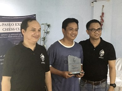 Michael Arman Caoile bested all the other participants with 5.5 points and the champion of June 2016 APECC Executive Chess Tournament. He was joined by APECC officers Val De Guzman and Roland Roselada (President) in this photo.
