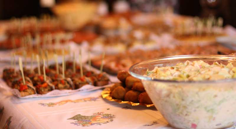 A buffet table filled with delicious looking food.
