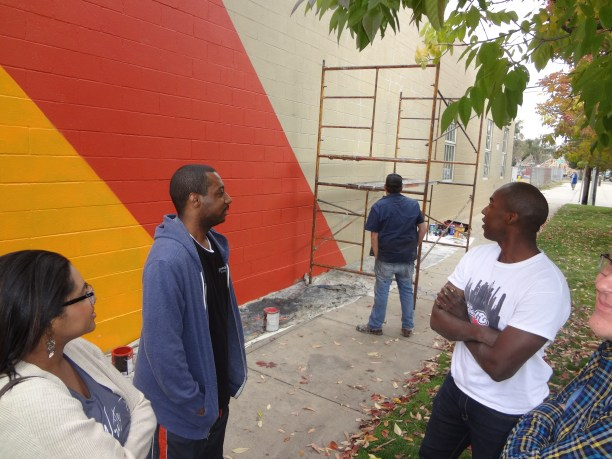 Detour chats in the middle of mural project
