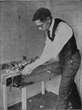 Fig. 1. - Bench top with quick-acting woodworking vise for use on a