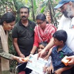 Prof Uma distributing medicines