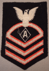 """Note that this Specialist """"A"""" CPO rating badge is fully embroidered which would typically date this as a post-war example. Earlier examples would typically have wool chevrons sewn onto the base material."""