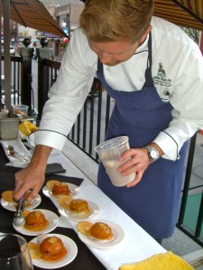 Ryan Burnham of Goldener Hirsch prepares peach desserts during the Association of Food Journalists' Taste of Park City.