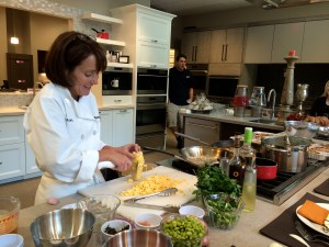 "Victoria Topham does a cooking demo in the ""living kitchen"" area filled with top-of-the-line appliances."