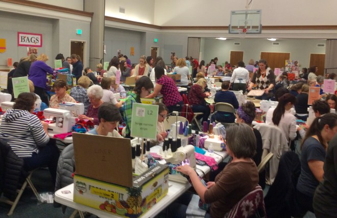 Women of the LDS (Mormon) Haight Creek Stake cutting, sewing and assembling Days for Girls feminine hygiene kits.