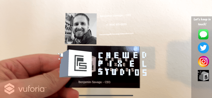 Photo of Chewed Pixel Studios business card with Augmented Reality.