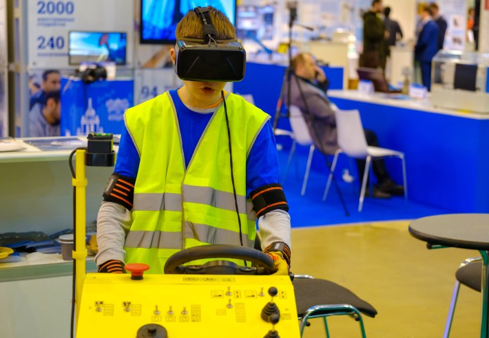 Child using training simulation with VR headset.