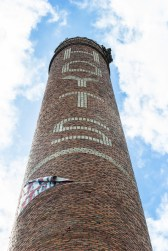 The smokestack still stands proud against the Spokane sky
