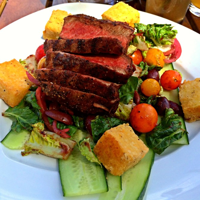 Grilled Steak Panzanella Salad: grilled bread / tomatoes / cucumbers / pickled onions / olives / fresh herbs / little gem / garlic-herb dressing