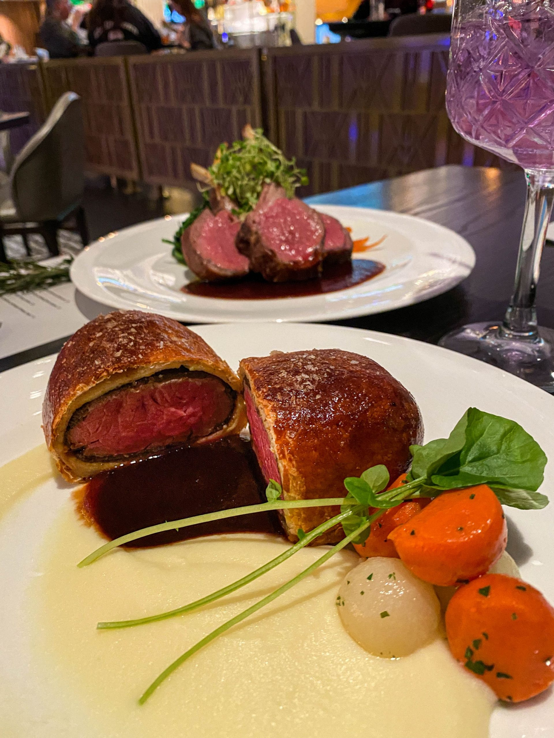 Beef Wellington with potato puree, glazed root vegetables, red wine demi-glace