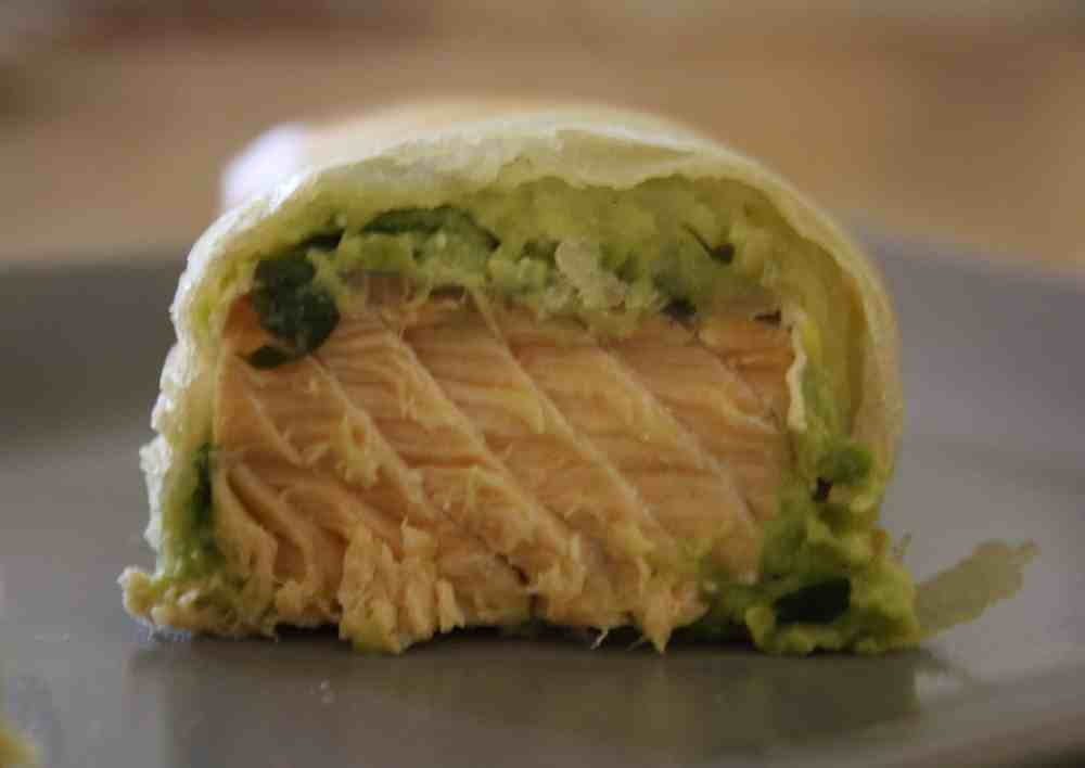 Salmon and Avocado Parcels. Lightly steamed salmon smeared with mashed avocado and coriander and then rolled up in Brik pastry and baked in the oven.