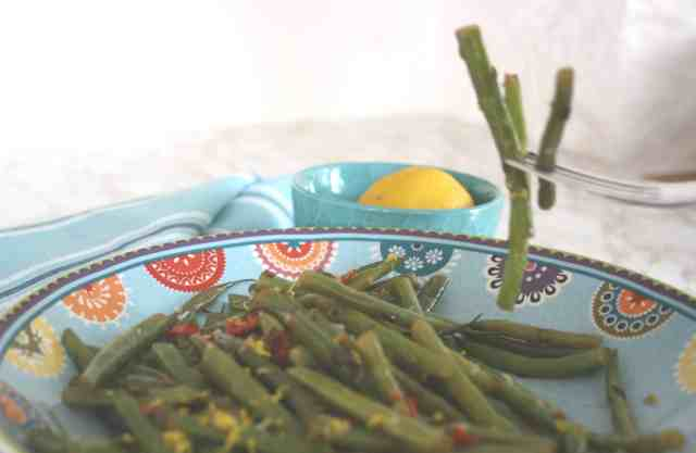 Spicy French Beans with Chilli and Cumin. French beans or haricot verts blanched thin quickly stir fried with cumin and chilli and tossed with lemon.